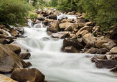 Blurred motion simple shot of mountain river — Stock Photo