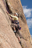 Senior lady on steep rock climb in Colorado — Stock Photo