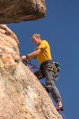 Senior man at top of rock climb in Colorado — Stock Photo