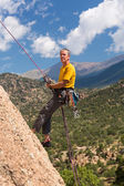 Senior man rappelling in Colorado — Stock Photo