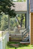 Wooden rocking chair on porch of old house — Stock Photo