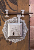 Antique silver door lock on timber — Stockfoto