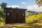 Wooden restroom in forest — Stock Photo