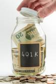 Hand opening glass Jar used for 401K fund — Stock Photo