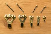 Set of picture hanging hooks and nails — Stock Photo