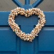 Heart shaped door wreath made from shells — Stock Photo #74074117