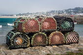 Lobster pots or traps on harbour wall in England — Stock Photo