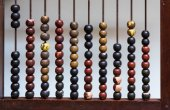 Antique abacus with painted wooden beads — Stock Photo