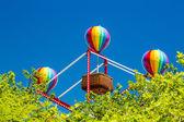 Colorful balloons on small basket ferris wheel — Stock Photo