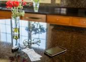 Pair of theater tickets on kitchen worktop — Stock Photo
