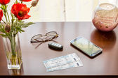 Pair of theater tickets on table with window — Stock Photo