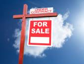 For Sale sign for home in front of blue sky — Stock Photo