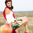 Young beautiful caucasian girl with pumpkin outdoors. — Stock Photo #52887619