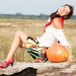 Young beautiful caucasian girl with pumpkin outdoors. — Stock Photo #52887665