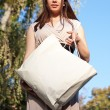 Woman leaving the mall with shopping bag. — Stock Photo #52911047