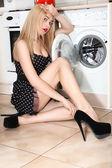 Pretty woman near washing machine — Stock Photo