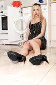 Pretty woman near washing machine. — Stock Photo