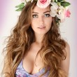 Beautiful women supermodel in wreath of flowers close up portrait. — Stock Photo #68258205
