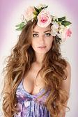 Beautiful women supermodel in wreath of flowers close up portrait. — Stock Photo
