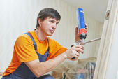 Carpenter works with foam — Stock Photo