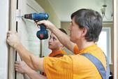 Door installation workers — Stock Photo