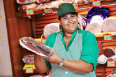 Shopping. Female worker in supermarket — Stock Photo
