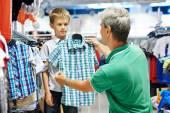 Man and boy shopping clothes — Stock Photo
