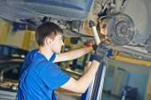 Auto mechanic at brake check — Stok fotoğraf