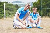 Family football players — Stock Photo