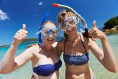 Happy vacation girls with snorkel masks — Stock Photo