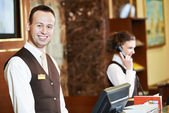 Hotel worker on reception — Stock Photo