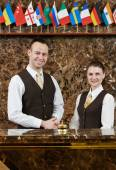 Hotel workers on reception — Stock Photo