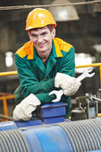 Happy industry worker repairman with spanner — Fotografia Stock