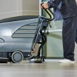 Worker cleaning floor with machine — Stock Photo #52491363