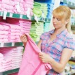 Woman choosing textile linen in shop — Stock Photo #52491503