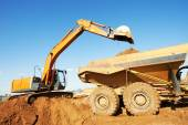 Wheel loader excavator and tipper dumper — Stock Photo