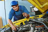 Auto mechanic repairman at work — Stock Photo