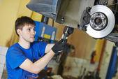 Auto mechanic at brake check — Stock Photo