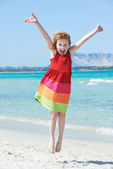 Exciting little girl at sea beach — Stock Photo