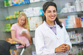 Pharmacy chemist portrait in drugstore — Stock Photo