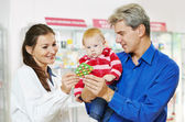 Pharmacy chemist, father and baby in drugstore — Stock Photo