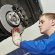 Auto mechanic at car brake shoes eximining — Stock Photo #53556711