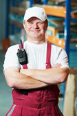 Warehouse worker in front storehouse — Stock Photo
