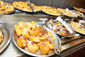 Pastry bun with fruit jam on buffet line — Stock Photo