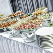 Catering service table with food set — Stock Photo #54636555