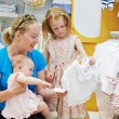 Woman with children in shop — Stock Photo #54637537