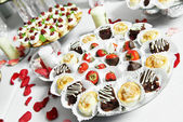 Strawberries with chocolate at catering party — Stock Photo