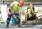 Travailleur de la construction avec perforateur — Photo