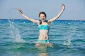 Exciting girl with sea water splashes — Stock Photo
