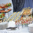 Catering service table with food set — Stock Photo #55534681